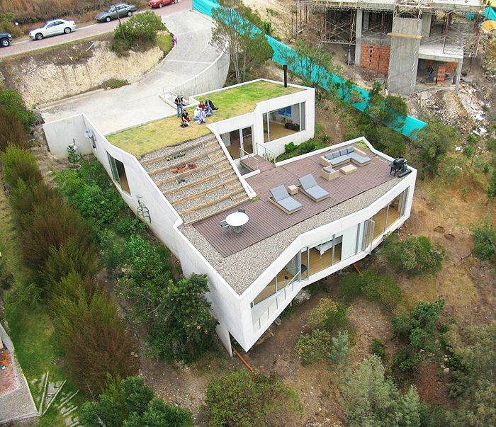 House On Slope With Rooftop Living Area .