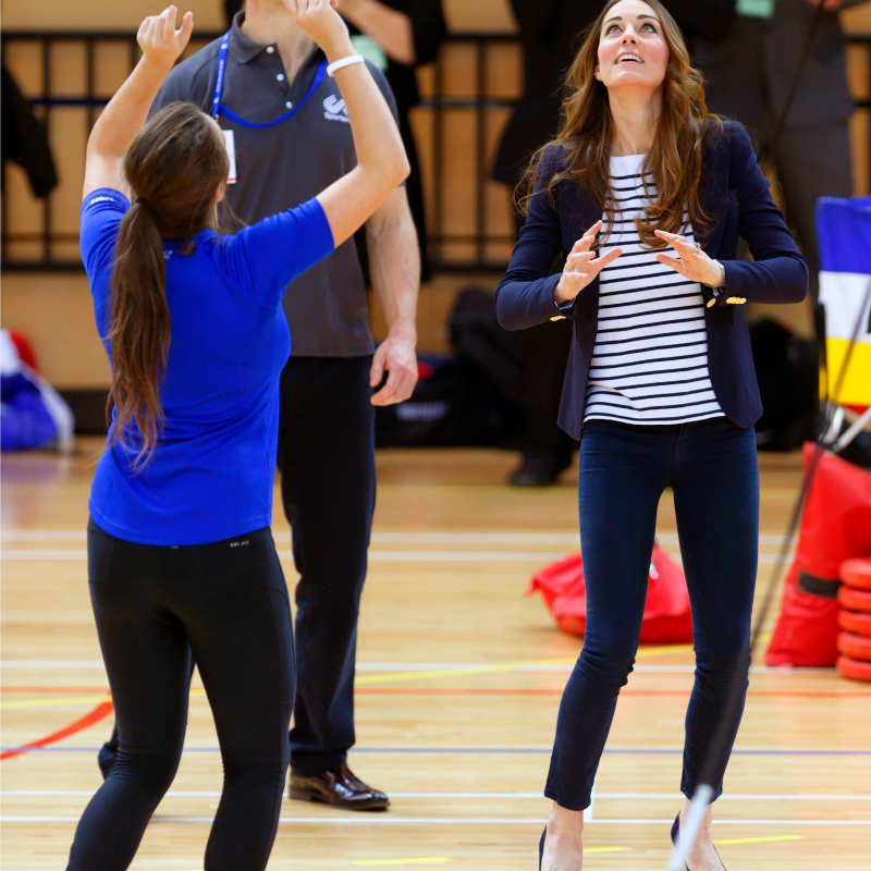 It looks like Kate is getting ready to spike the ball in her signature striped shirt and jeans look, plus a comfortable blazer.