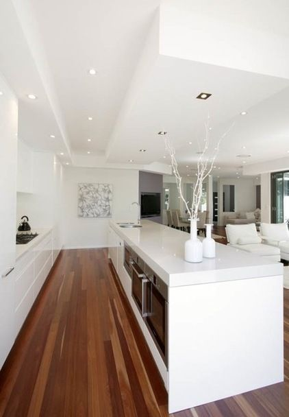 white kitchen , island bench with oven etc to overlooking