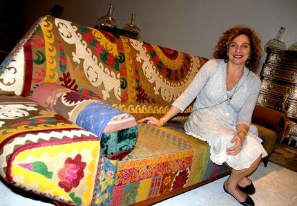 Artist Hoda Baroudi with recycled vintage Persian fabric sofa from her company, BOKJA   Examiner.com