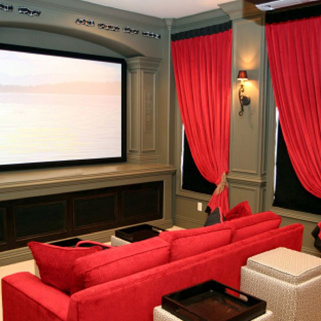 Home movie theater - Maybe change the color scheme a bit, but I like the idea of have a big couch in there.