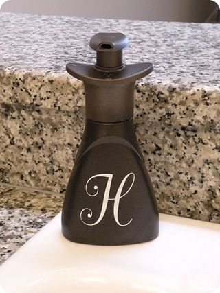 paint a hand soap pump with oil rubbed bronze spray paint to match faucets...love this