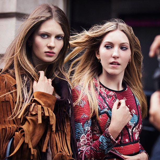 Ella Richards and Florence Kosky take to the streets of St James's with The Bucket Bag in suede fringing and camouflage print for the new Burberry campaign