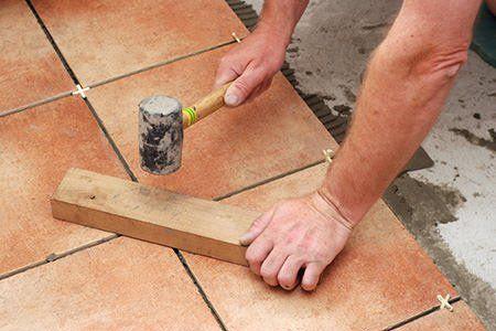 How To Level A Basement Floor Doityourself Com Basement Flooring Basement Flooring Options Installing Tile Floor