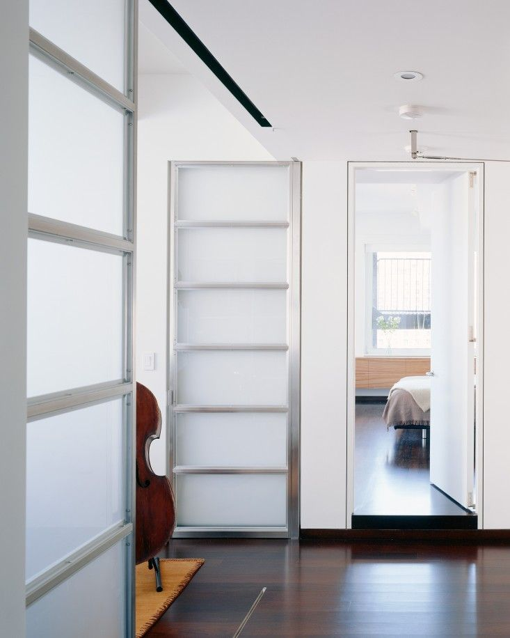 NY loft by Delson Sherman full height translucent stainless steel and etched glass doors & The Architect Is In: Seeking Sunlight in Chelsea   Walnut floors ...