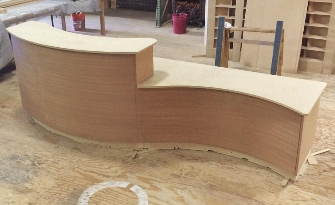 Curved reception desk ready for finish Sapele on the front and