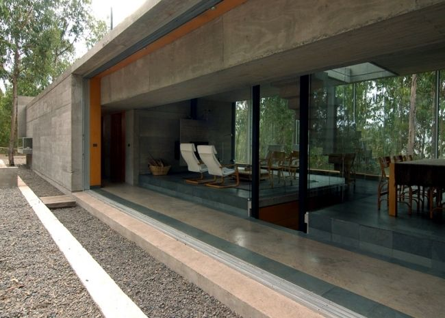 The coach house on a hillside impressed with massive concrete structure
