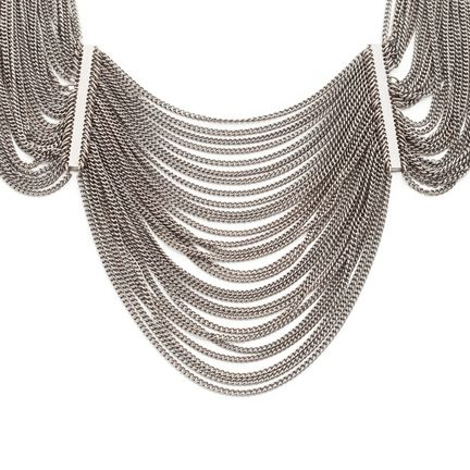 Thin hematite chains drape in three sections to form the Brielle - statement form