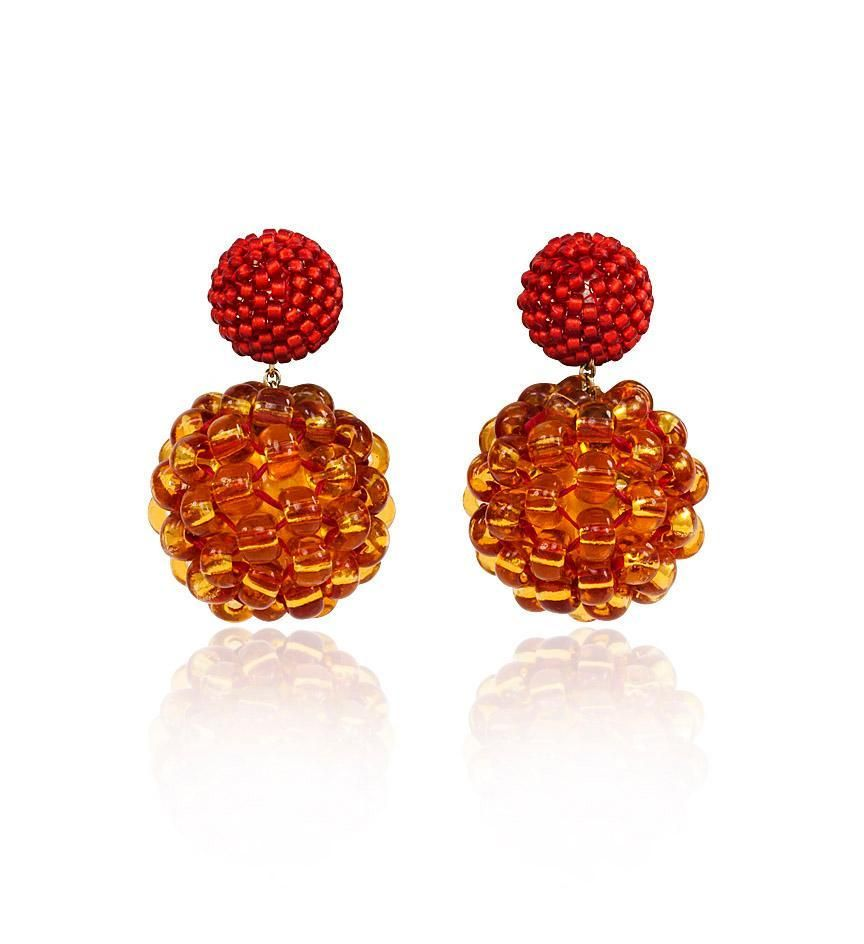 A pair of handmade double bead earrings, in lmatte bright red silver lined and topaz, with red thread over yellow. Axel Russmeyer