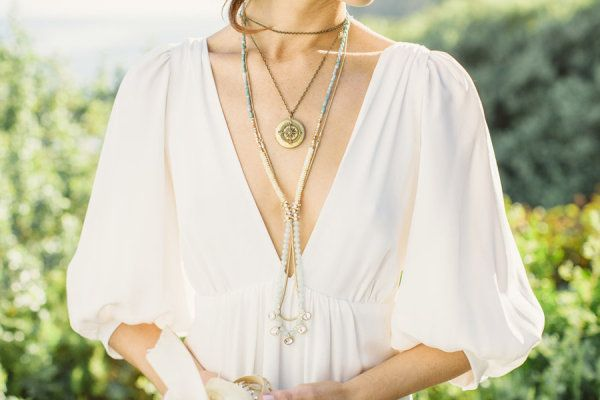 layered necklaces and plunging neckline