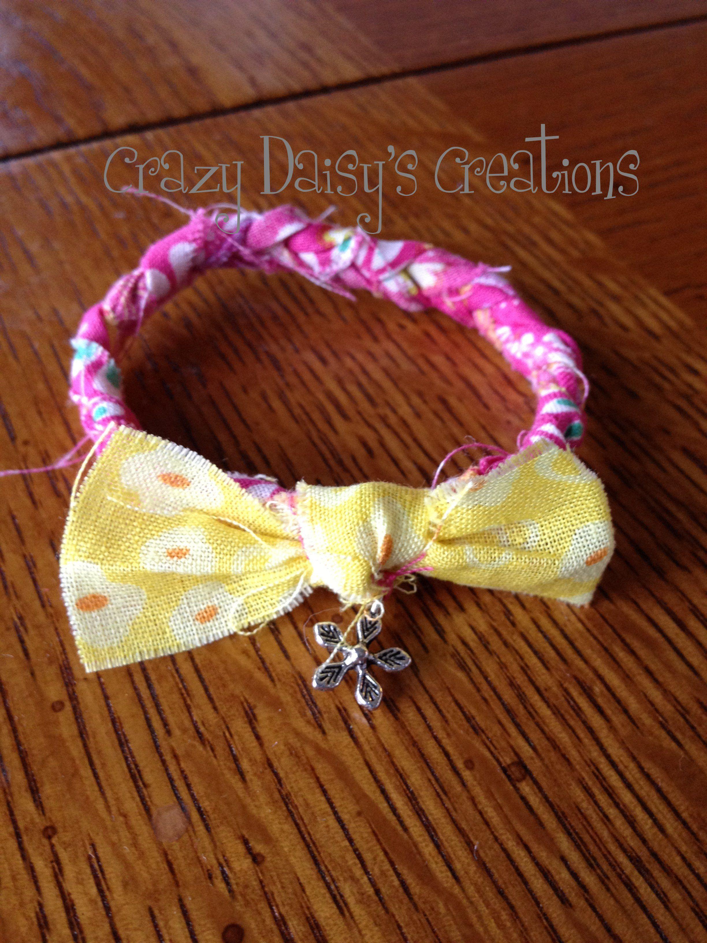 Fabric bracelet with daisy charm