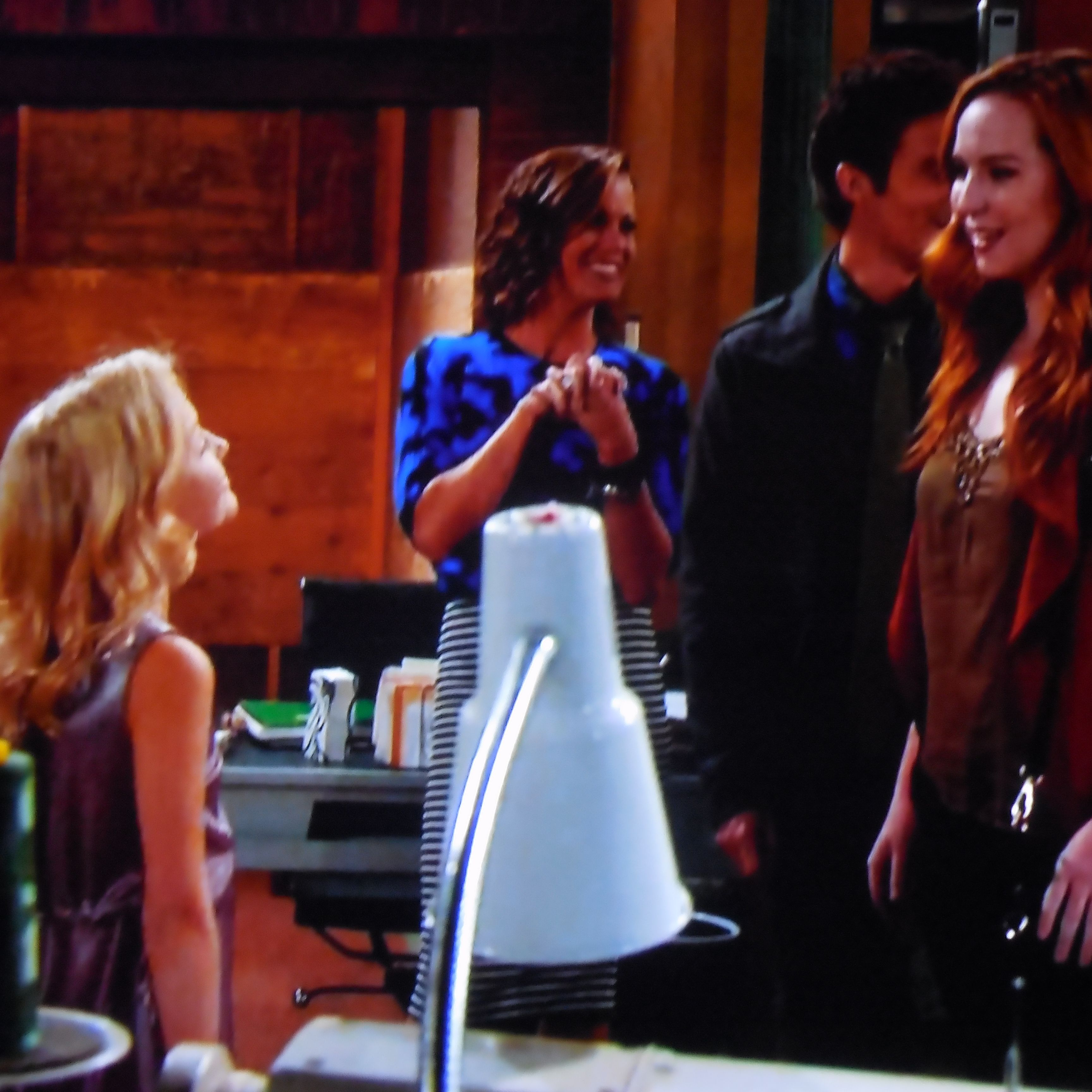 Faith proudly shows Kevin and Mariah her new birthday dress.