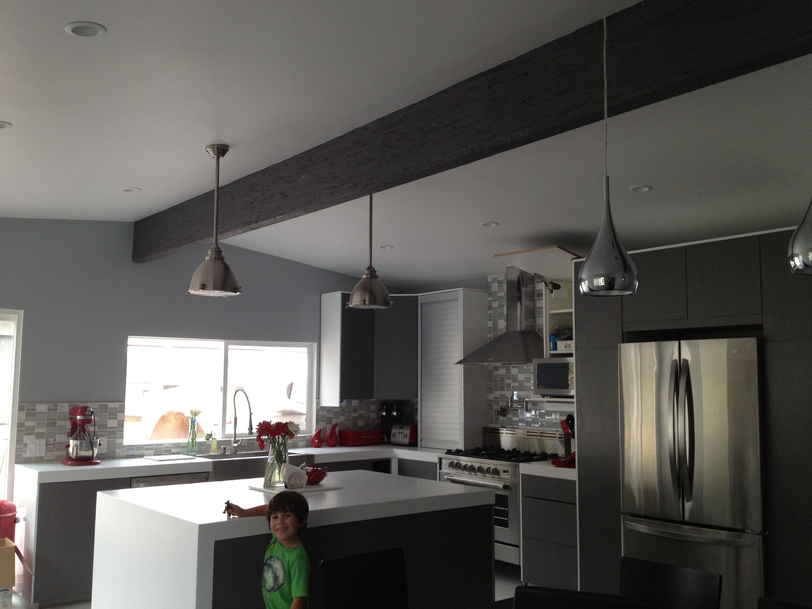 Grey And White Kitchen With Red Accents Featuring Kohler Vault