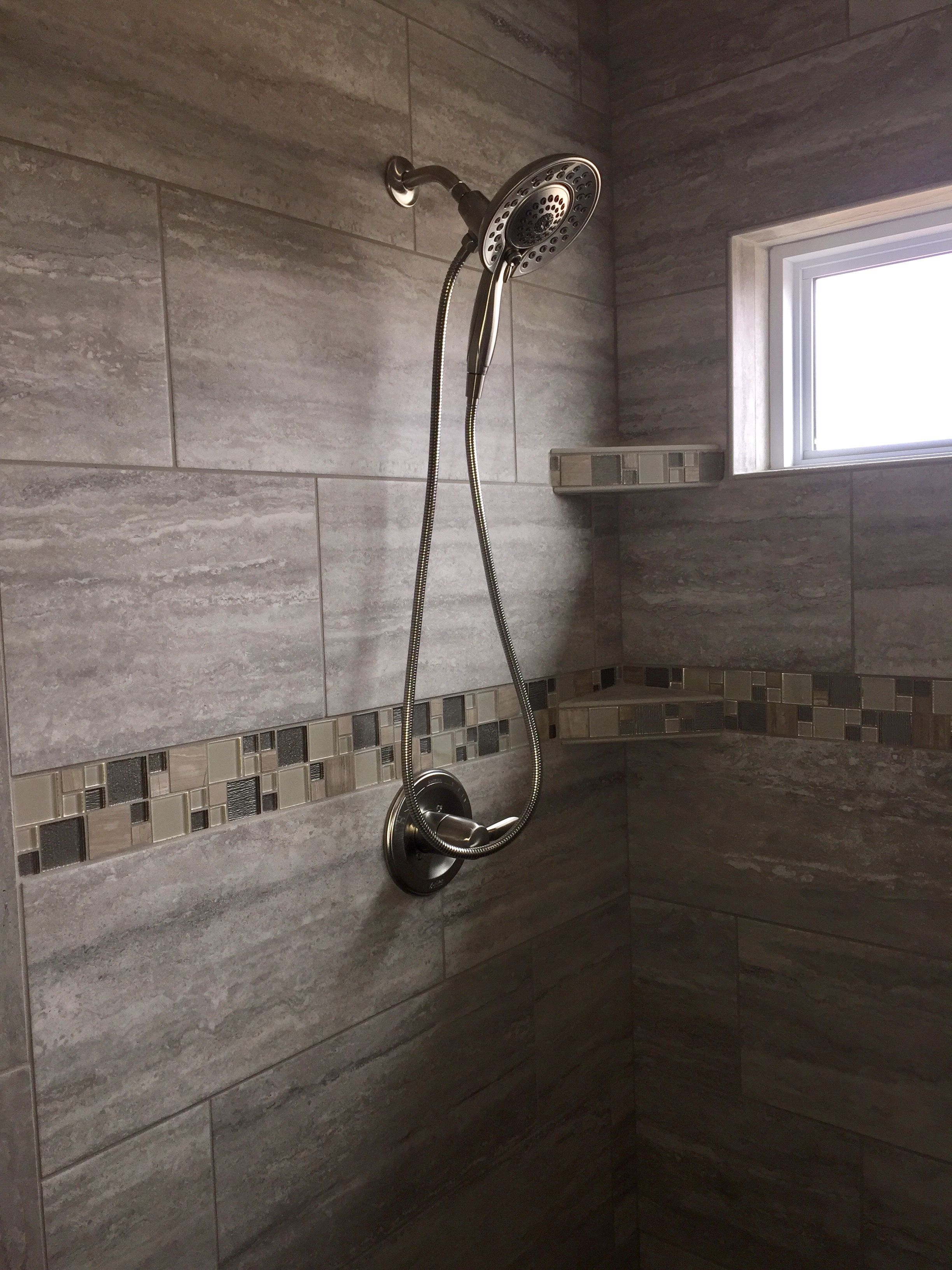 Custom Tiled Shower In A 12x24 Porcelain Tile Installed At A 1 3 Staggered Horizontal With A Stone And Glass A Custom Tile Shower Shower Tile Tile Installation