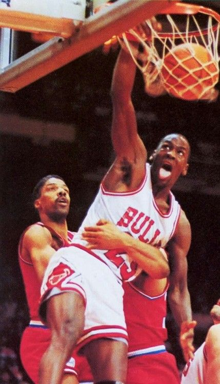 "Michael Jordan giving Julius ""Dr.J"" Erving that work #slamdunk"