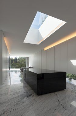 Aluminum House by Fran Silvestre Arquitectos features a metallic and horizontal facade which produces the effect of having just one storey. With its proportions and materiality it both contrasts and blends with the tall trees of its environment #bedroom #marble