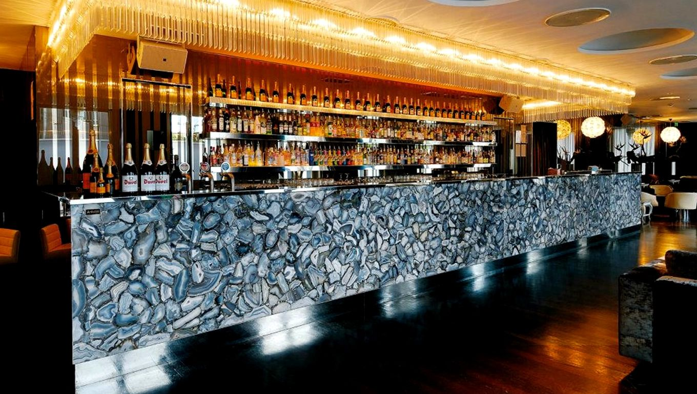 commercial interior with wild agate dark stoneantolini luigi