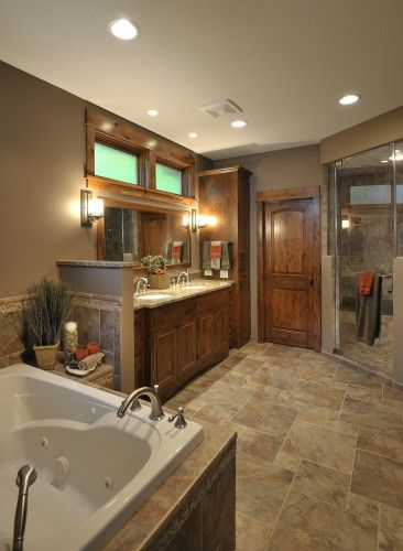 Master Bathroom!!! The color is great, it has the stone shower which I love.  His and Hers sink is a most.  The wood door is beautiful.