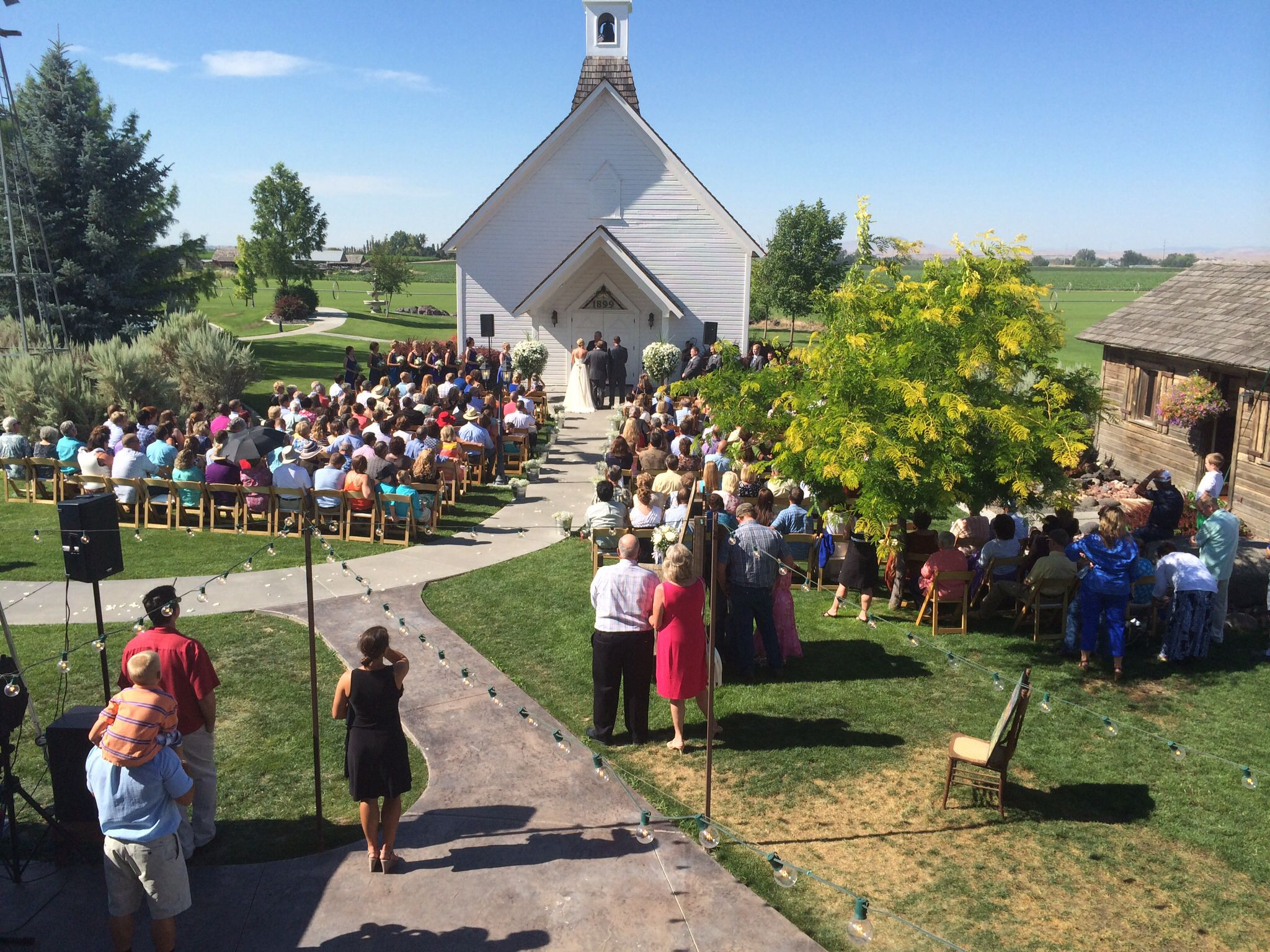 Wedding In Front Of The Little White Chapel At Still Water Hollow Nampa Idaho