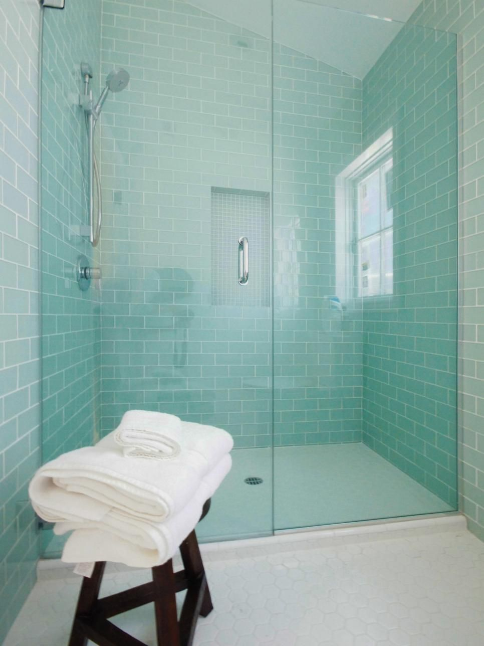 Mint-colored subway wall tiles create a serene setting in this cozy ...