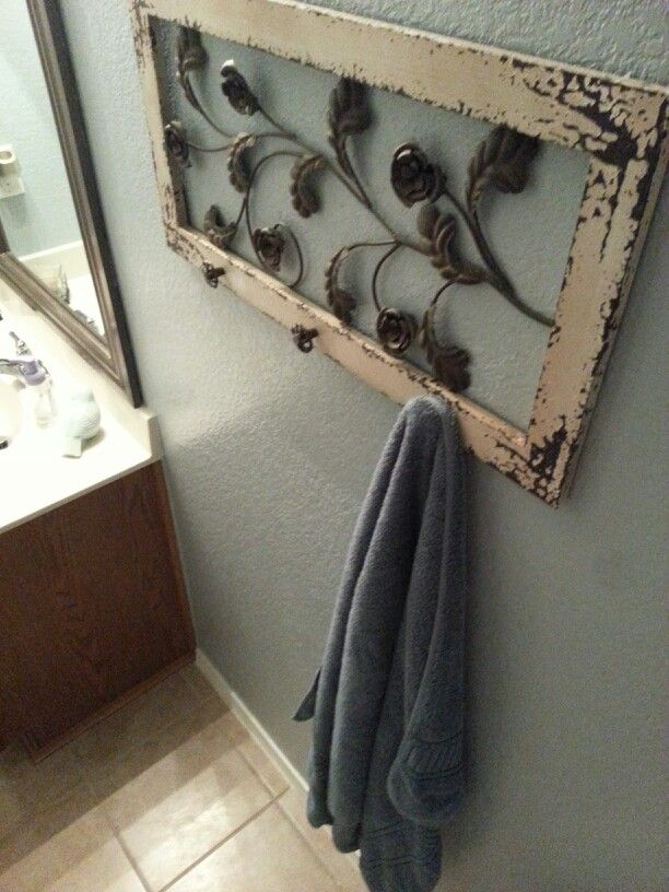 Chabby chic wall art mad into towel holder by adding knobs. DIY bathroom towel holder. So easy to do!