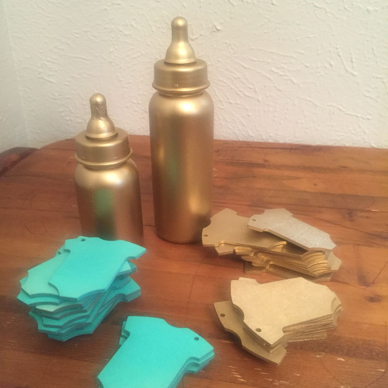 Dollar Ideas! Spray painted baby bottles and cute sign in tags for baby!! You can purchase these online message for info!