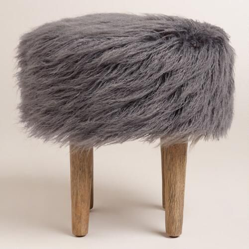 Featuring a plush charcoal gray faux fur top inspired by the flokati wool shag rugs of Greece, our fun and modern hardwood footstool is ideal in front of an accent chair or at the foot of a bed.