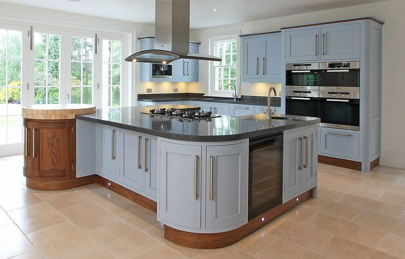 Shaker kitchen with curved cabinets and Walnut plinths ...