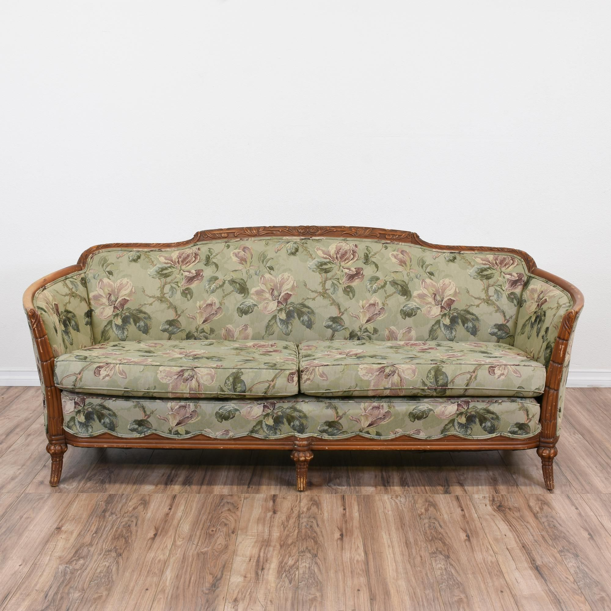 This sofa is upholstered in a durable sage green needlepoint