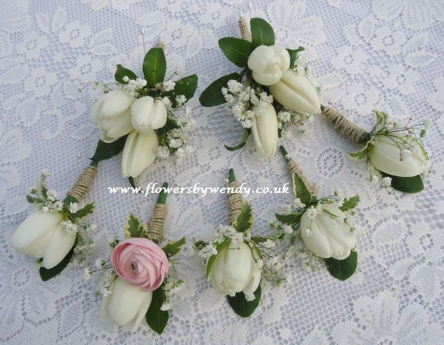 Buttonholes for a spring wedding __ white tulips
