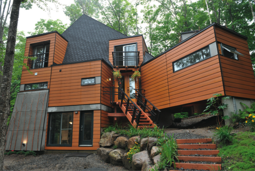 affordable shipping container house in quebec this time in the day time spring - Sea Container Home Designs