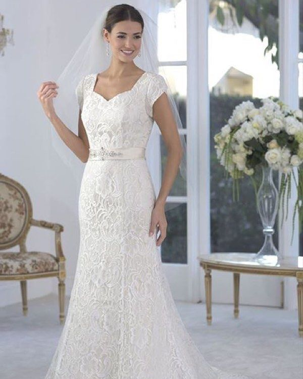 An intricate lace dress perfect for the #modestbride.  #StyleOfTheWeek #utahbrides #weddingdress