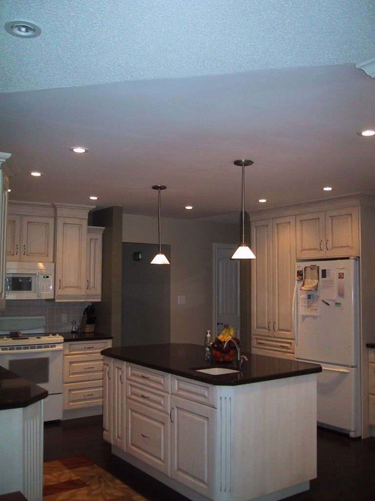I wish i had a kitchen this big maybe some day love the lighting