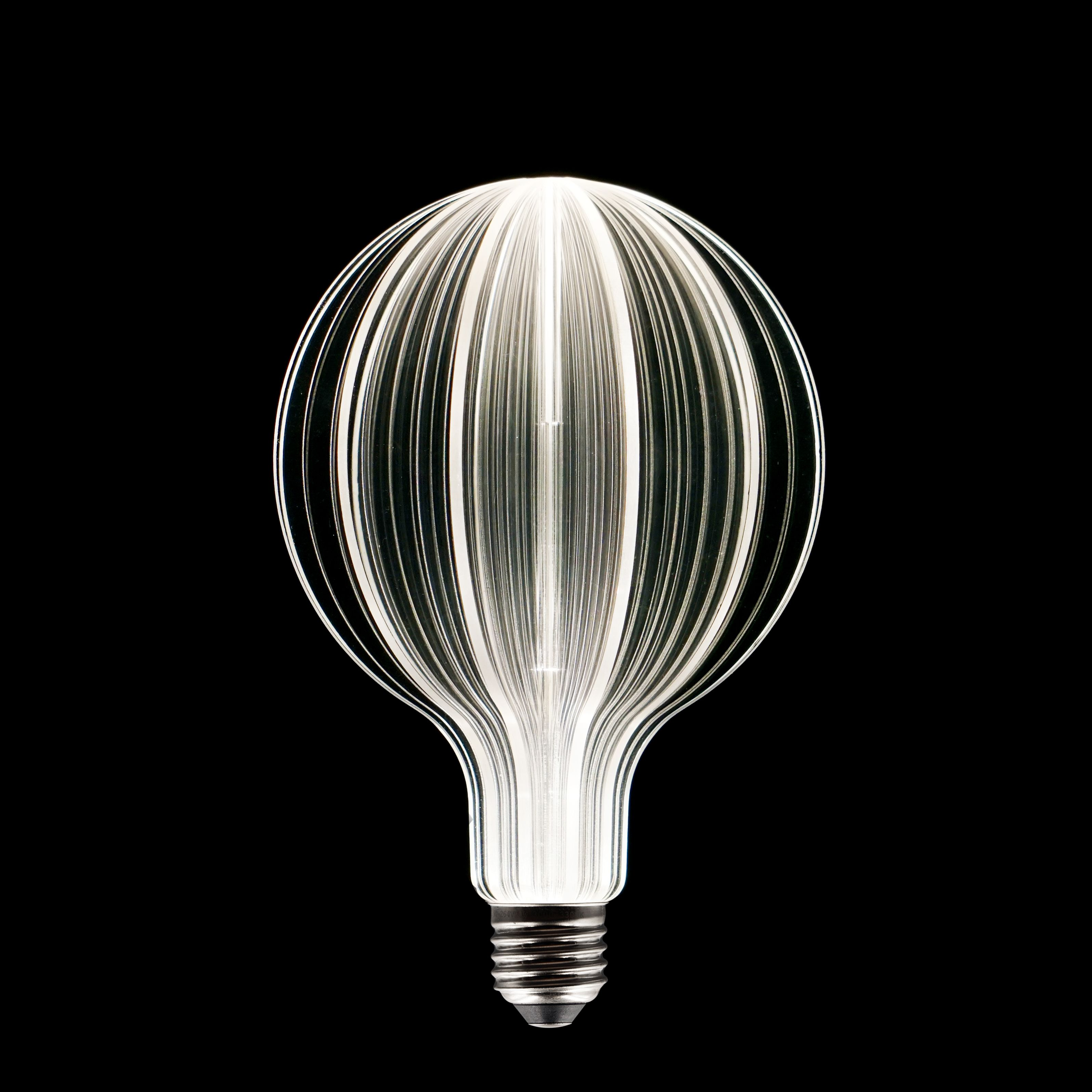 A Sparkling Universe Uri Laser Etched Led Light Bulb Sun From The Uri Collection Design Lighting Lightbulb Led Light Bulb Light Bulb Globe Light Bulbs