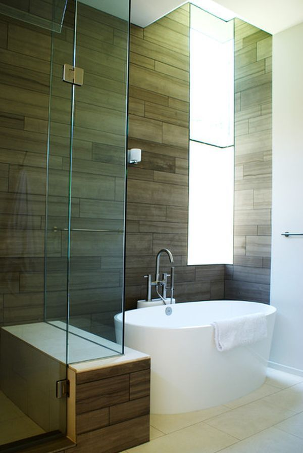 Image On Modern bathroom featuring a tiny white tub and pact shower unit