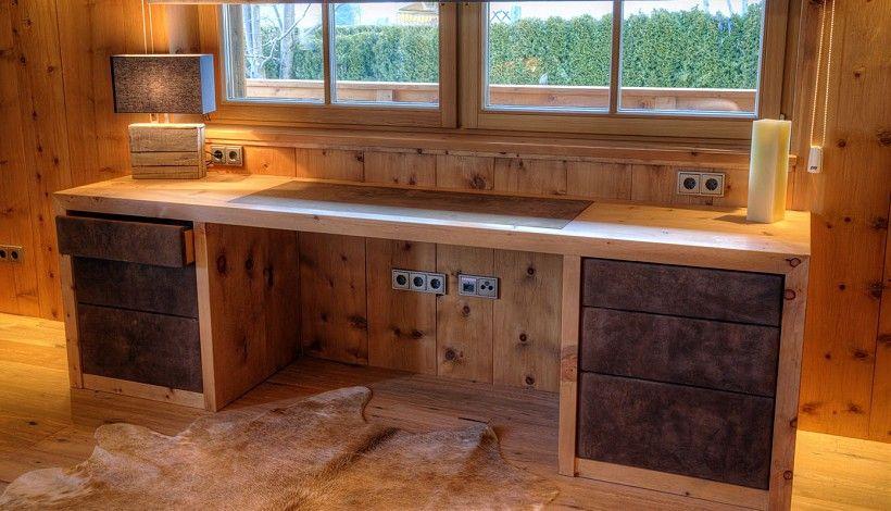 Lovely Schreibtisch aus massivem Zirbenholz mit Hirschlederfronten bezogen