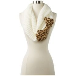 Put the finishing touches on your ensemble with this fabulous Betsey Johnson scarf! Infinity design.Ribbed design throughout.Large leopard print bow detail at side.Sequin accents.100% acrylic.Hand was