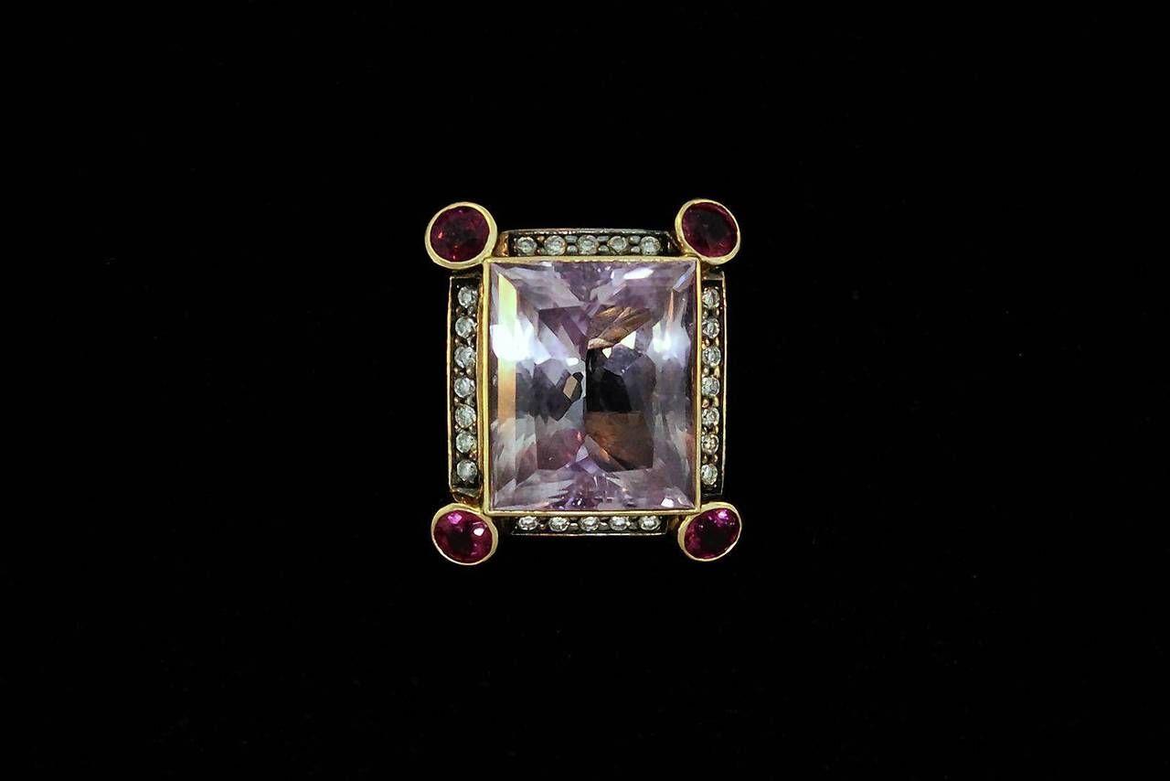 Ladies 18 karat yellow gold kunzite, pink tourmaline, diamond and pink sapphire ring.