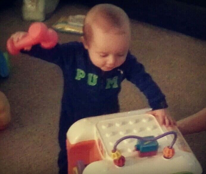 What a little busy man! Practicing his building skills at eight months! What a little superstar!