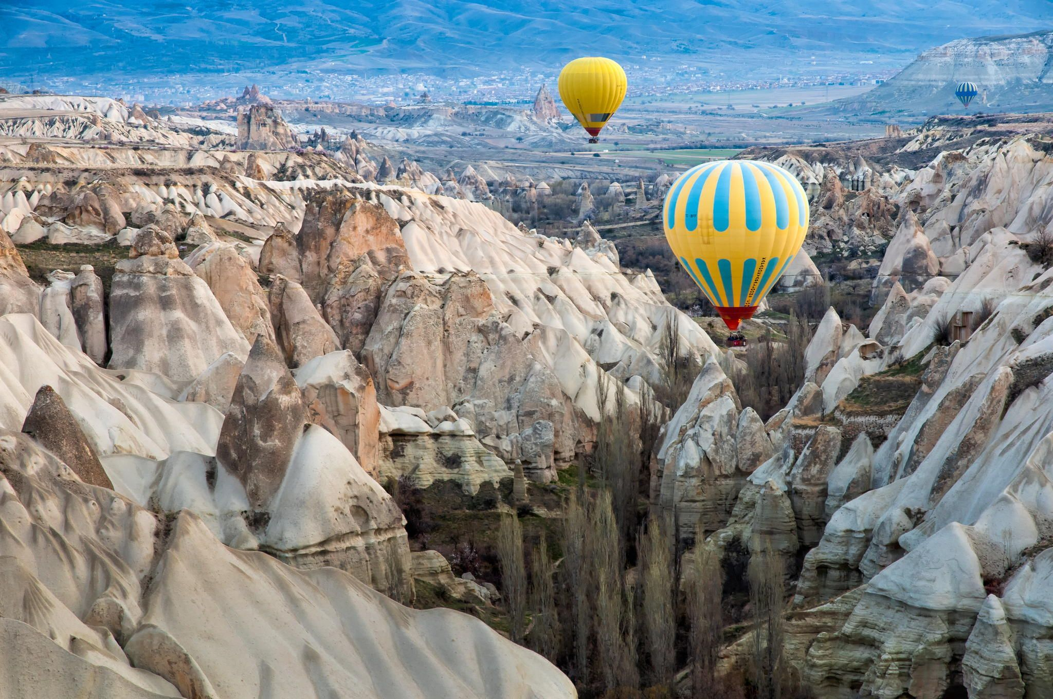 Flying hot air balloon over Cappadocia by Natapong P. on
