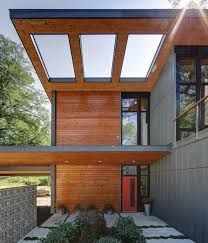 Cantilever Patio Cover Minimalist Interior: Entrance Courtyard With  Cantilevered Overhang Wood Roof With Skylight And Stained Cedar Siding Also  Concrete ...