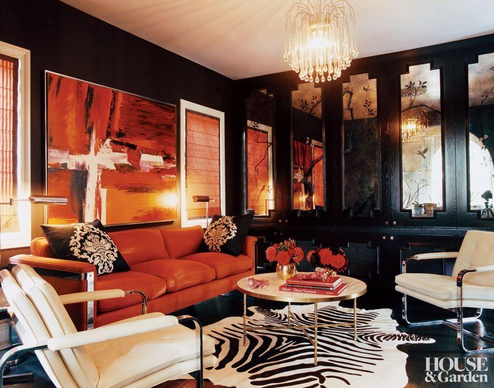 black walls perfectly balance the bright tangerine
