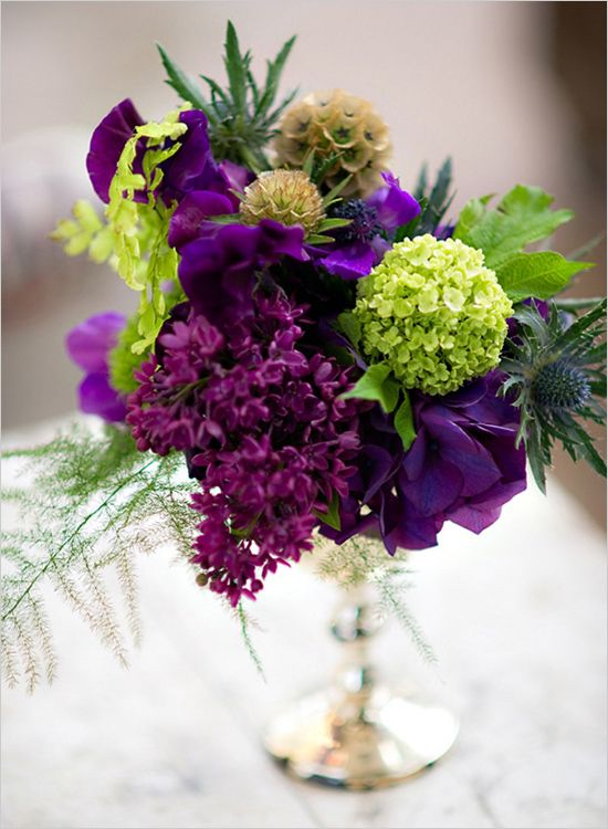 Purple and green wedding flowers tablescape centerpiece