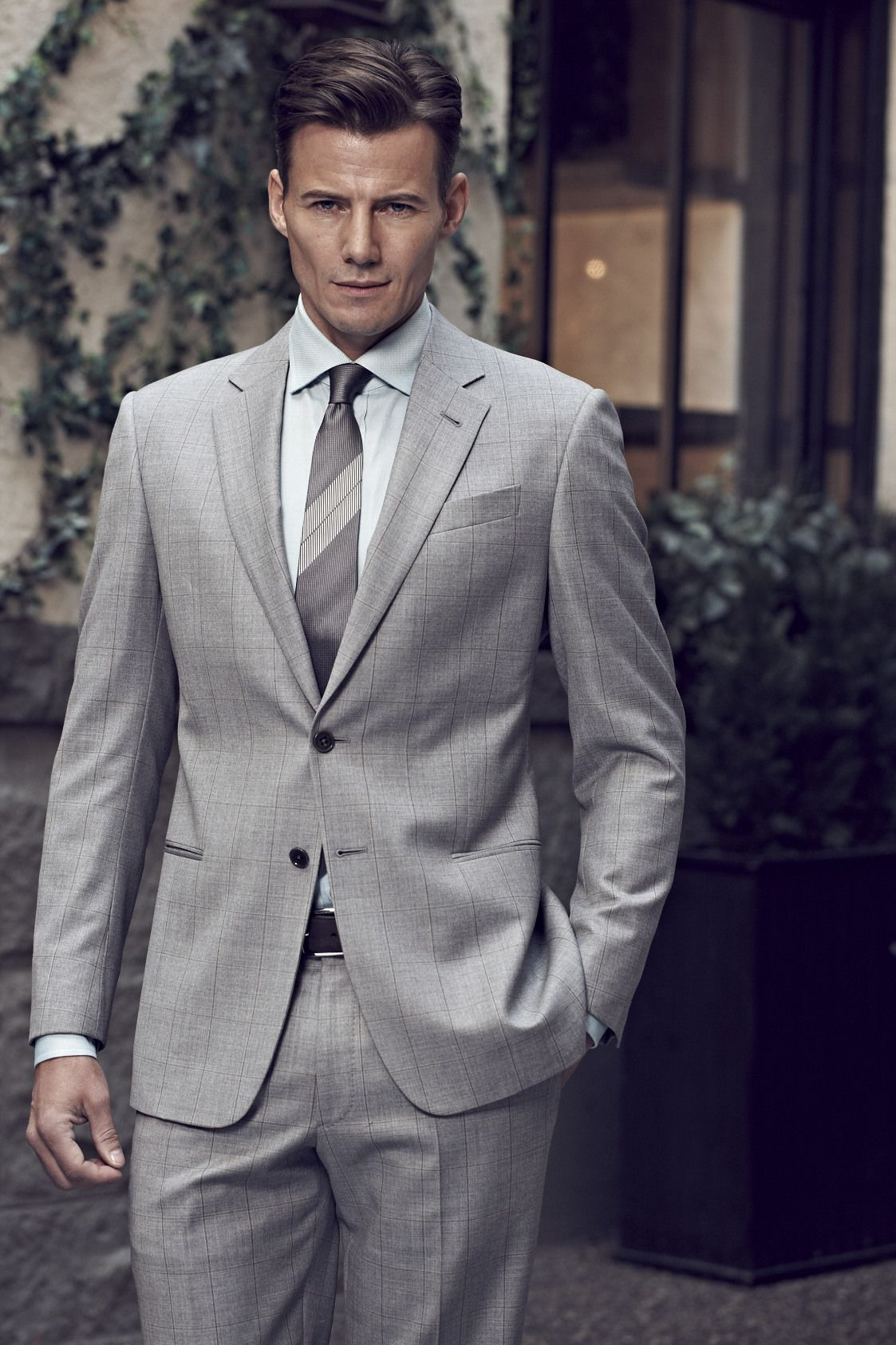 36f1c4d6fb1 Armani Collezioni  Windowpane wool suit in grey.  2295 Modern cotton oxford  shirt in aqua.  295 Large striped silk tie in grey.  175  holtsmag
