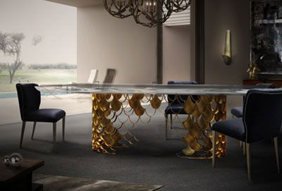 Koi dining table by Brabbu. Here is an example of a bright dining room design ideas. The natural light of the room contrast with the soft light that the pendant light gives out.