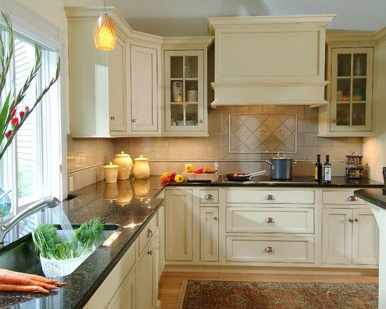 Classic Kitchen Using Uba Tuba Granite With White Cabinets