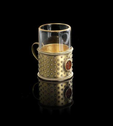 A miniature gold tea-glass holderFabergé, workmaster Erik Kollin, St. Petersburg, circa 1890