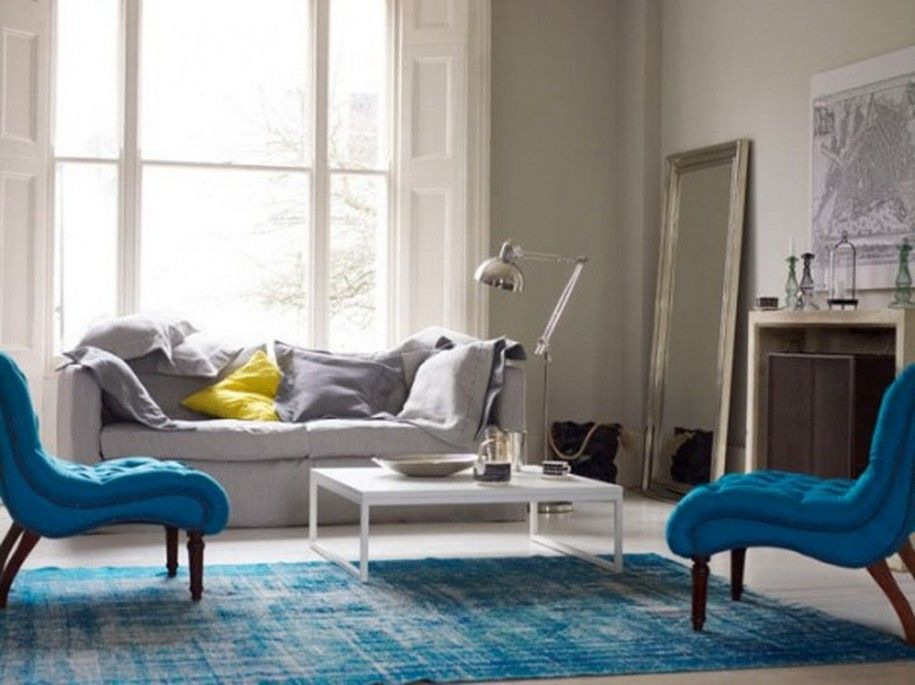 Blue Themed Living Room Ideas With Rug On The White Floor And Light Grey Fabric Sofa Also Two Chair Wooden Legs Square Table In