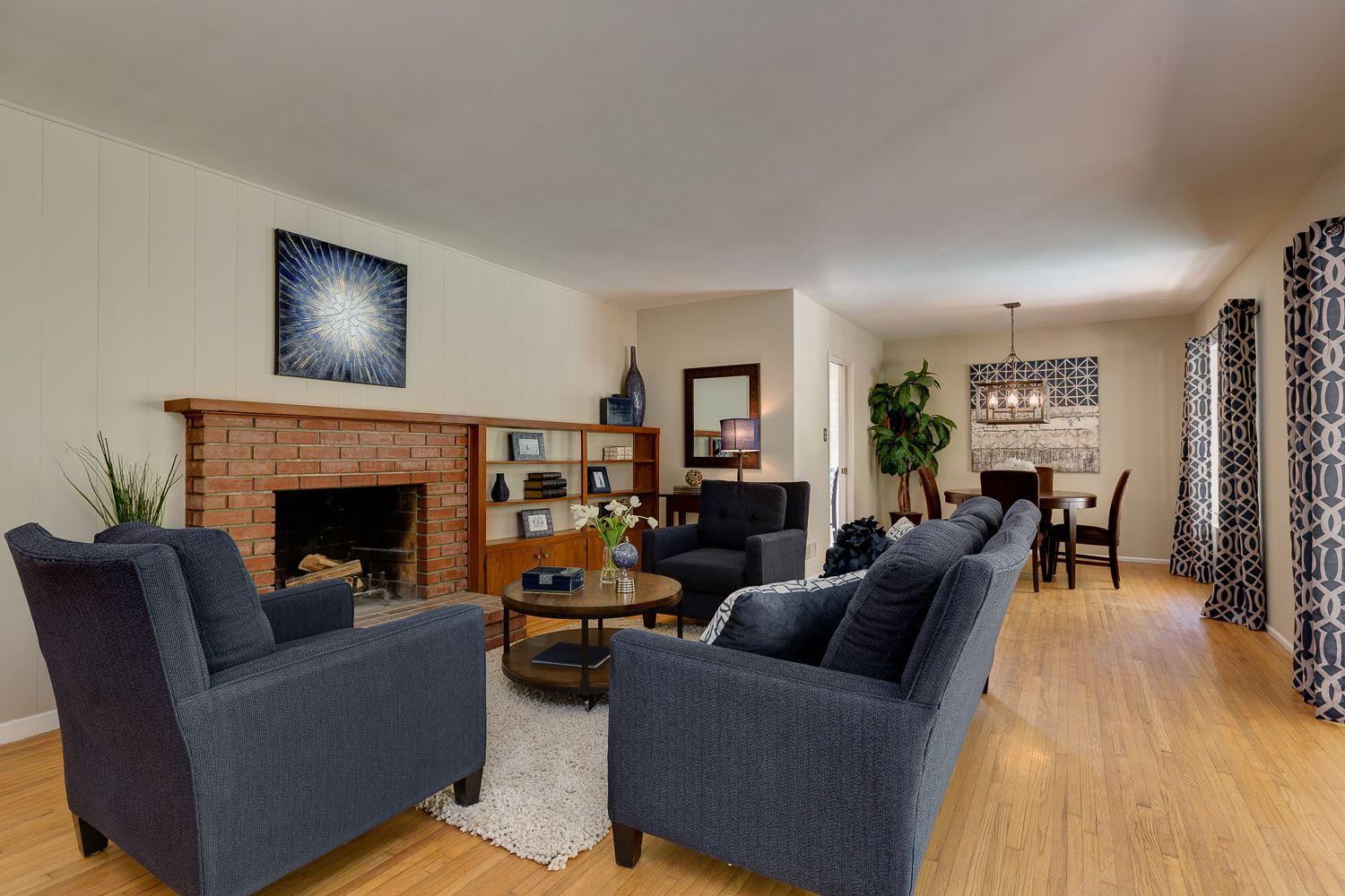 Blue Sofa With Brick Fireplace And Light Hardwood Floors Blue Sofa With Brick Fireplace And Light Hardwood F Light Hardwood Floors Brick Fireplace Wall Color