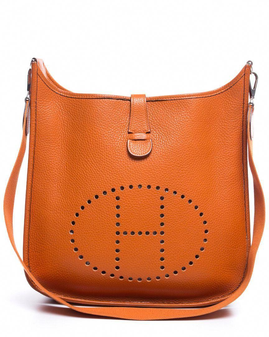 4e40374eaf2 Hermes Orange Taurillon Clemence Leather Evelyne II GM is on Rue. Shop it  now. #Hermeshandbags
